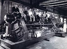 People sitting on machine